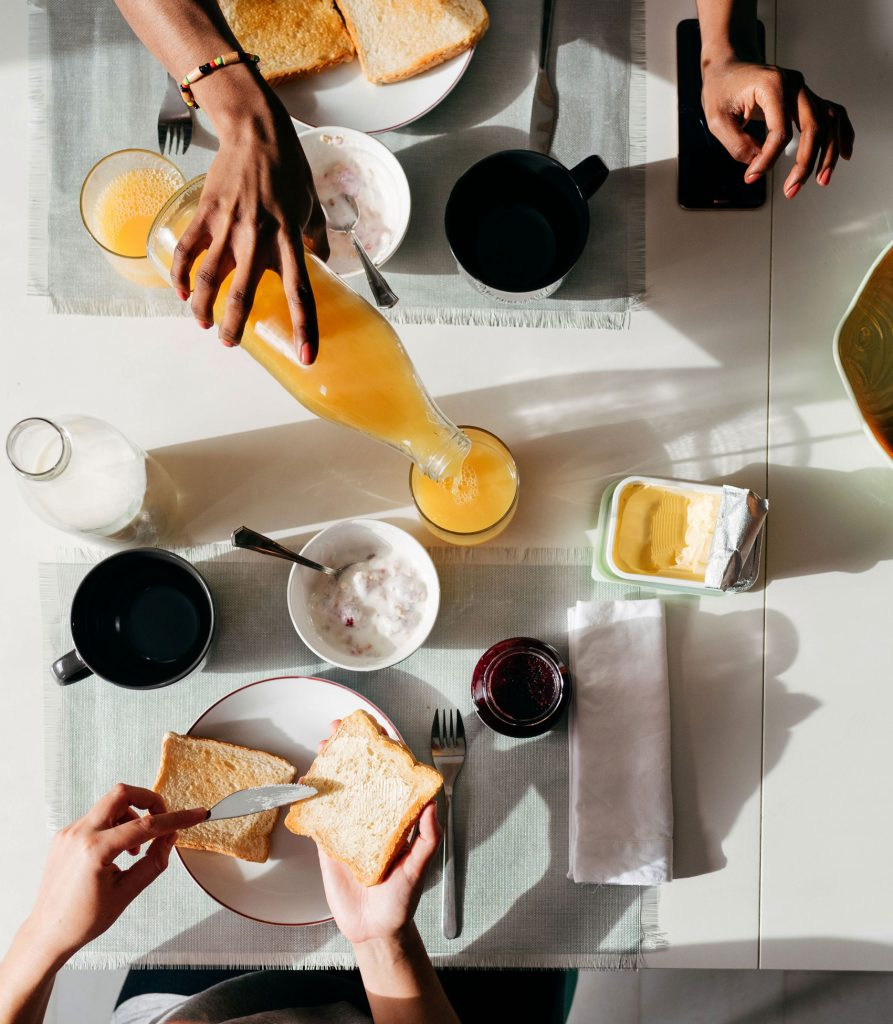 image of a breakfast with orange juice