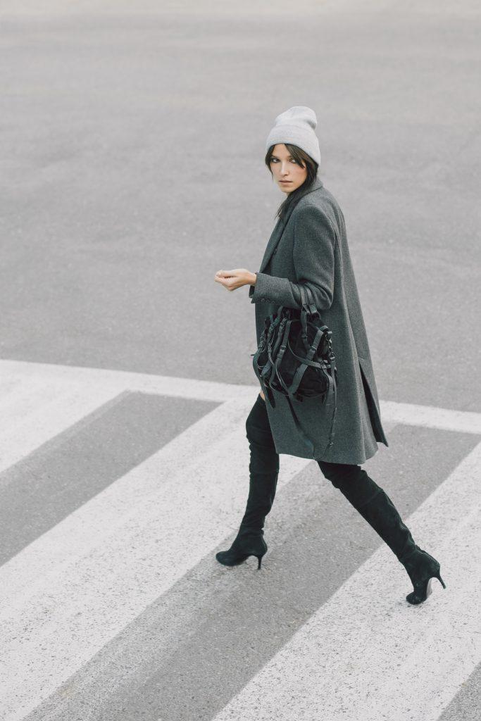 image of a woman walking across the street